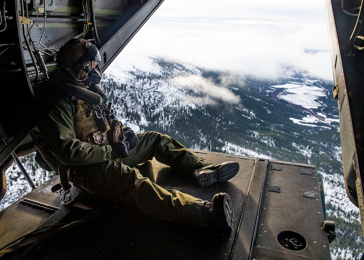U.S. Marine Cpl. Nicholas Adams, a crew chief, flies aboard a MV-22B Osprey during Trident Juncture 18 at Vaernes Air Base, Norway, Nov. 1, 2018. The exercise enhances the U.S. and NATO Allies' and partners' abilities to work together collectively to conduct military operations under challenging conditions. Both the Marine and the MV-22B Osprey are with Marine Medium Tiltrotor Squadron 365, 2nd Marine Aircraft Wing. (U.S. Marine Corps photo by Lance Cpl. Cody J. Ohira)
