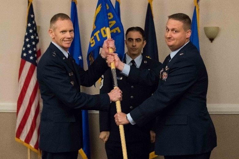 U.S. Air Force Lt. Col. David H. Donatelli II, outgoing 608th Strategic Operations Squadron commander, relinquishes command to Maj. Gen. James Dawkins Jr., 8th Air Force and J-GSOC commander, during a deactivation ceremony at Barksdale Air Force Base, La., Oct. 15, 2018. The 608th STOS has supported joint operations since June 4, 2004. (U.S. Air Force photo by Airman 1st Class Tessa Corrick)