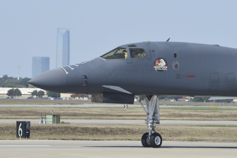 B-1B Lancer, 86-0109, 'Spectre' taxis at Tinker Air Force Base, Oklahoma, Oct. 26, 2018, with parts of the Oklahoma City skyline visible in the background. The jet was ferried from Midland International Air and Space Port to Tinker where it will undergo depot-level maintenance and upgrades with the Oklahoma City Air Logistics Complex today. During a routine training flight May 1, the Dyess AFB based B-1B had an in-flight emergency resulting in an attempted ejection. The first crewmembers' seat failed to deploy and the aircraft commander halted the ejection sequence and heroically saved the aircraft and crew by landing at Midland International Air & Space Port.
