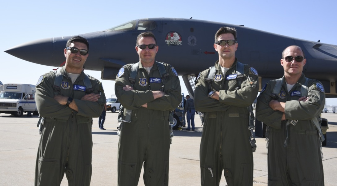 10th Flight Test Squadron flight crew for B-1B Lancer, 86-0109, pose for a group photo after ferrying the aircraft from Midland International Air & Space Port to Tinker Air Force Base, Oklahoma, on Oct. 26, 2018. Shown are: Maj. Ivan Vian; pilot and aircraft commander, Lt. Col. James Couch; Offensive Weapons System Officer, Maj. Michael Griffin; copilot and Lt. Col. Matthew Grimes; Defensive Weapons System Officer. The damaged B-1B will undergo depot-level maintenance and upgrades with the Oklahoma City Air Logistics Complex Oct. 26, 2018. During a routine training flight May 1, the Dyess AFB based B-1B had an in-flight emergency resulting in an attempted ejection. The first crewmembers seat failed to deploy and the aircraft commander halted the ejection sequence and heroically saved the aircraft and crew by landing at Midland International Air & Space Port.