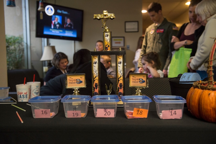 The trophies for trunk-or-treat sit on the entrance table behind the voting boxes during the 10th annual Fall Festival, October 31, 2018, at Altus AFB, Okla.