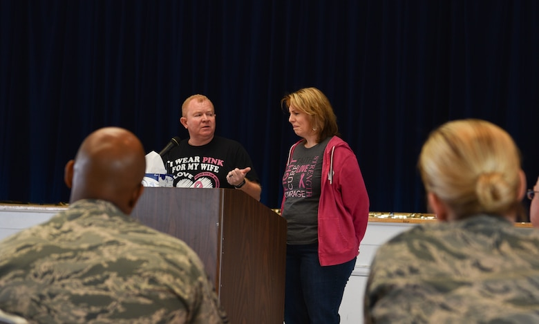 John Coffey, 90th Civil Engineer Squadron carpenter, stands and speaks to a group of people about the hardships of breast cancer on a family, Oct. 24, 2018, on F.E. Warren Air Force Base, Wyo. After skin cancer, breast cancer is the most common form of cancer in women. (U.S. Air Force photo by Airman 1st Class Braydon Williams)