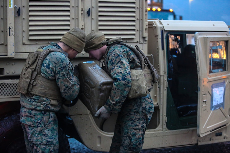 U.S. Marines with II Marine Support Battalion, II Marine Information Group, refuel a Humvee during a convoy operation for Exercise Trident Juncture 18 in Norway, Nov. 2, 2018. Trident Juncture 18 demonstrates II Marine Expeditionary Force's ability to deploy, employ, and redeploy the Marine Air Ground Task Force while improving interoperability with NATO allies and partners. (U.S. Marine Corps photo by Cpl. Patrick Osino)