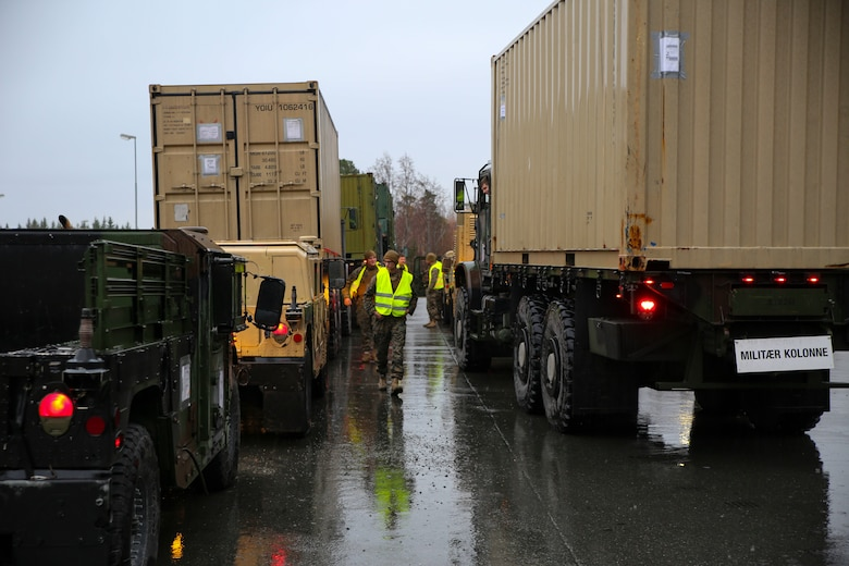 .S. Marines with II Marine Support Battalion, II Marine Information Group get accountability of vehicles during a convoy operation for Exercise Trident Juncture 18 in Norway, Nov. 2, 2018. Trident Juncture 18 demonstrates II Marine Expeditionary Force's ability to deploy, employ, and redeploy the Marine Air Ground Task Force while improving interoperability with NATO allies and partners. (U.S. Marine Corps photo by Cpl. Patrick Osino)