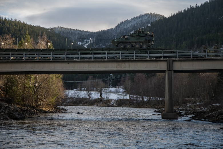 Light Armored Vehicles with 2nd Light Armored Reconnaissance, cross a medium girder bridge as part of Exercise Trident Juncture 18 near Voll, Norway, Oct. 30, 2018. The bridge construction enables ground units to complete a gap crossing during the exercise, which is one of the general engineering tasks 2nd Marine Logistics Group provides to the Marine Air-Ground Task Force. Trident Juncture 18 enhances the U.S. and NATO Allies' and partners' abilities to work together collectively to conduct military operations under challenging conditions. (U.S. Marine Corps photo by Lance Cpl. Scott R. Jenkins)