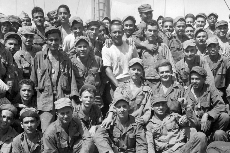 Service members pose for a photo.
