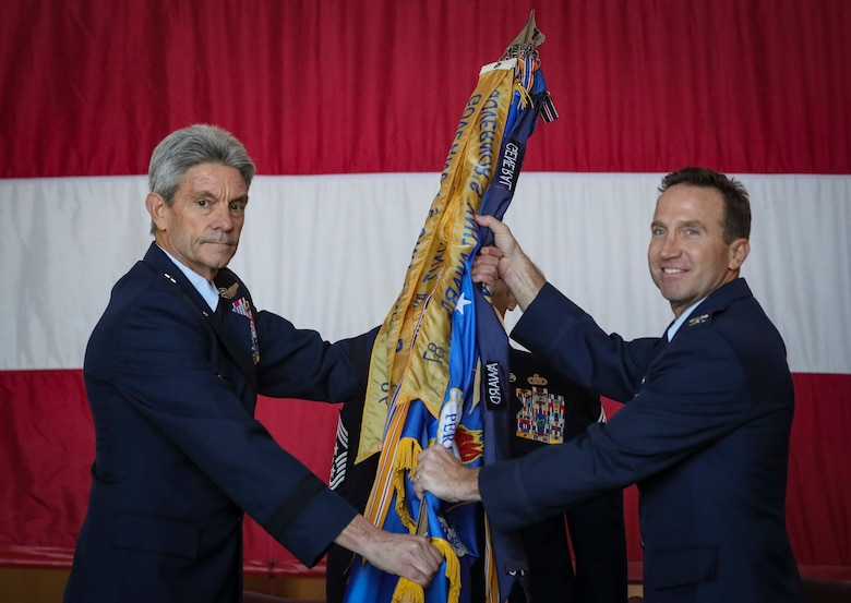 Brig. Gen. Kevin J. Keehn, left, commander of the New Jersey Air National Guard, passes the guidon to incoming 108th Wing commander Col. John M. Cosgrove during a change of command ceremony on Joint Base McGuire-Dix-Lakehurst, N.J., Nov. 4, 2018.