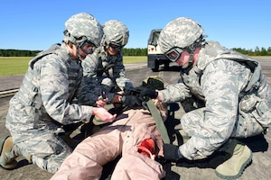 """Members of the 36th Aeromedical Evacuation Squadron, which is a part of the 403rd Wing at Keesler Air Force Base, Mississippi, prepare an """"injured"""" patient for airlift during an exercise Nov. 4, 2018, at Camp Shelby, Mississippi. The 403rd Wing participated in an exercise during the November 2018 Unit Training Assembly to test their ability to survive and operate in a deployed environment. (U.S. Air Force photo by Tech. Sgt. Ryan Labadens)"""