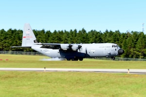 """A C-130J Super Hercules aircraft from the 815th Airlift Squadron, which is a part of the 403rd Wing at Keesler Air Force Base, Mississippi, lands at Camp Shelby, Mississippi, to transport an """"injured"""" patient to Keesler Air Force Base, Mississippi, during an exercise Nov. 4, 2018. The 403rd Wing participated in an exercise during the November 2018 Unit Training Assembly to test their ability to survive and operate in a deployed environment. (U.S. Air Force photo by Tech. Sgt. Ryan Labadens)"""