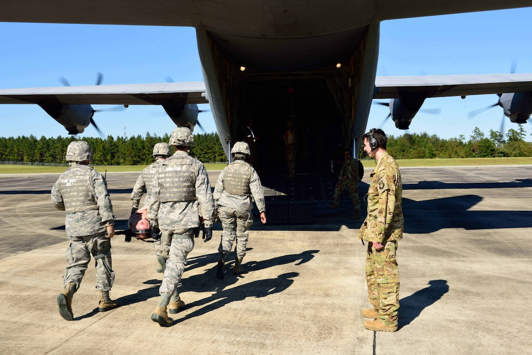 "Members of the 36th Aeromedical Evacuation Squadron, which is a part of the 403rd Wing at Keesler Air Force Base, Mississippi, use a litter to carry an ""injured"" patient to a C-130J for aeromedical evacuation during an exercise Nov. 4, 2018, at Camp Shelby, Mississippi. The 403rd Wing participated in an exercise during the November 2018 Unit Training Assembly to test their ability to survive and operate in a deployed environment. (U.S. Air Force photo by Tech. Sgt. Ryan Labadens)"
