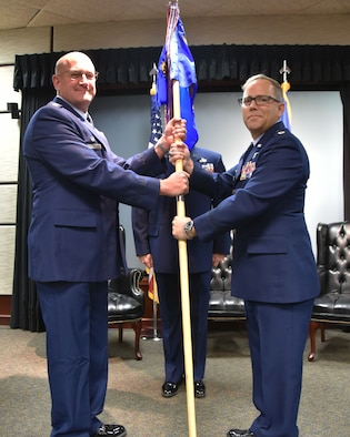 (Left to right) Col. Kevin Rainey, 931st Operations Group commander, hands the guidon to Lt. Col Matthew Ghormley, incoming 931st Operations Support Squadron commander, during a change of command ceremony Nov. 4, 2018, McConnell Air Force Base, Kan.  Prior to this assignment, Ghormley was assigned to the Programs and Requirements Division, Office of Air Force Reserve, at the Pentagon, Va.  (U.S. Air Force photo by Tech. Sgt. Abigail Klein)