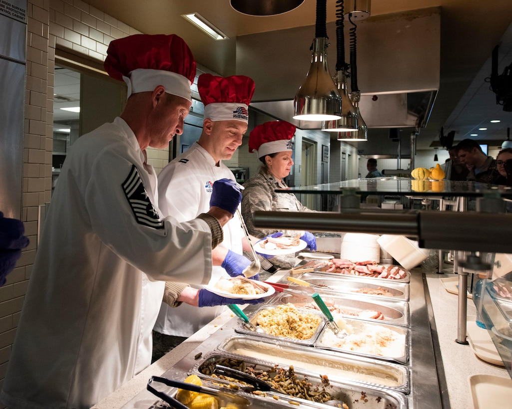 Leaders from the 141st Air Refueling Wing serve a holiday meal to Airmen at the Warrior Dining Facility Nov. 3, 2018 on Fairchild Air Force Base, Wash. As part of the holiday season, commanders, chiefs, and first sergeants volunteer their time to take part in serving a traditional holiday meal every November drill weekend. (U.S. Air National Guard photo by Staff Sgt. Rose M. Lust)