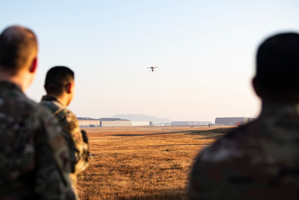 U.S. Air Force Airmen from the 8th Civil Engineer Squadron, observe a quadcopter taking off at Kunsan Air Base, Republic of Korea, Nov. 2, 2018. The 8th CES trains using small, unmanned aerial systems to survey the airfield at a quicker pace and larger scale, honing a capability that can be used in the aftermath of natural disasters to survey damage. (U.S. Air Force photo by Senior Airman Stefan Alvarez)