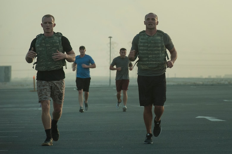 Competitors perform a 400-meter run as part of the 2018 EOD 133 Memorial Workout Nov. 4, 2018, at Al Udeid Air Base, Qatar. The event was held in honor of U.S. Army Sgt. James Slape, 430th Explosive Ordnance Company, who was killed by an improvised explosive device Oct. 4, 2018. (U.S. Air Force photo by Tech. Sgt. Christopher Hubenthal)