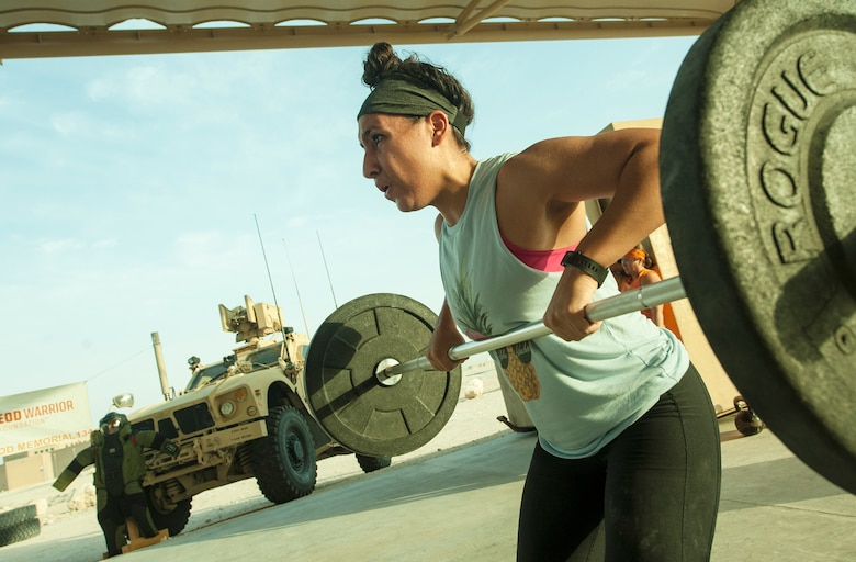 U.S. Air Force Capt. Angelique Draina, 609th Air Operations Center, participates in the 2018 EOD 133 Memorial Workout Nov. 4, 2018, at Al Udeid Air Base, Qatar. The event was held in honor of U.S. Army Sgt. James Slape, 430th Explosive Ordnance Company, who was killed by an improvised explosive device Oct. 4, 2018. (U.S. Air Force photo by Tech. Sgt. Christopher Hubenthal)