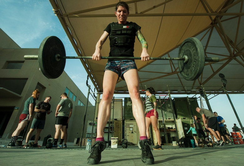 U.S. Air Force Maj. Ashley Parker, 746th Expeditionary Airlift Squadron, participates in the 2018 EOD 133 Memorial Workout Nov. 4, 2018, at Al Udeid Air Base, Qatar. The event was held in honor of U.S. Army Sgt. James Slape, 430th Explosive Ordnance Company, who was killed by an improvised explosive device Oct. 4, 2018. (U.S. Air Force photo by Tech. Sgt. Christopher Hubenthal)