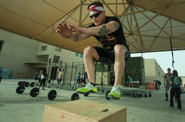 U.S. Air Force Staff Sgt. Cory Lesinger, 329th Expeditionary Civil Engineer Squadron, performs box jumps during the 2018 EOD 133 Memorial Workout Nov. 4, 2018, at Al Udeid Air Base, Qatar. The event was held in honor of U.S. Army Sgt. James Slape, 430th Explosive Ordnance Company, who was killed by an improvised explosive device Oct. 4, 2018. (U.S. Air Force photo by Tech. Sgt. Christopher Hubenthal)