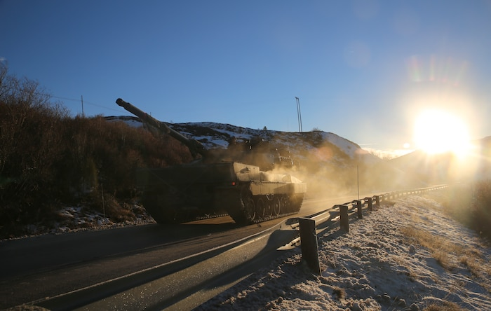 Spanish forces participating in Exercise Trident Juncture 18 hold a defensive position against U.S. Marines with 2nd Tank Battalion, 2D Marine Division, near Dalholen, Norway, Nov. 3, 2018. Trident Juncture 18 enhances the U.S. and NATO Allies' and partners' abilities to work together collectively to conduct military operations under challenging conditions.