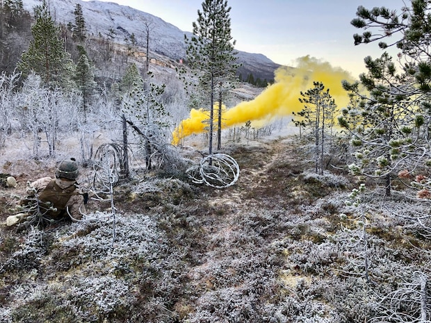 A U.S. Marine with Marine Rotational Force-Europe 19.1, sets a marker during a squad attack as a part of Exercise Northern Screen in Setermoen, Norway, Nov. 28, 2018. The exercise increases the Marines' proficiency in cold-weather, arctic, and mountainous environments.
