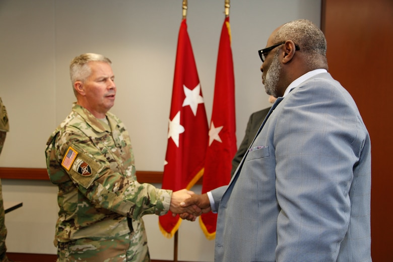 Lt. Gen. Todd Semonite, the 54th Chief of Engineers and Commanding General of the U.S. Army Corps of Engineers greeted Arthur Saulsberry, Small Business Deputy for the Kansas City District, after a Town Hall Meeting in Kansas City October 24, 2018.