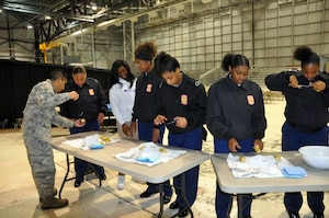 Tech. Sgt. Christian De La Cruz, 445th Aeromedical Evacuation Squadron, teaches suturing techniques to students from Meadowdale High School during the Dayton public schools outreach event Oct. 18, 2018.