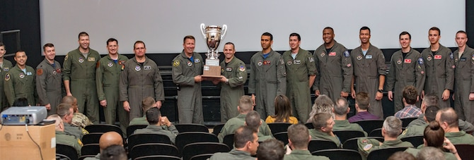 "U.S. Air Force Maj. Gen. Patrick Doherty, 19th Air Force commander (center), presents the ""Top Wing of Wings"" award to Vance Air Force Base, Oklahoma at the 2018 Air Education and Training Command's 2018 Flying Training Awards ceremony at Joint Base San Antonio-Randolph, Texas, Oct. 26. 2018. The second annual event, hosted by the 19th Air Force, recognized the dedicated efforts of the exceptional individuals and teams across AETC who continue to produce highly qualified aircrew for the Air Force over the last fiscal year. (U.S. Air Force photo by Senior Airman Stormy Archer)"