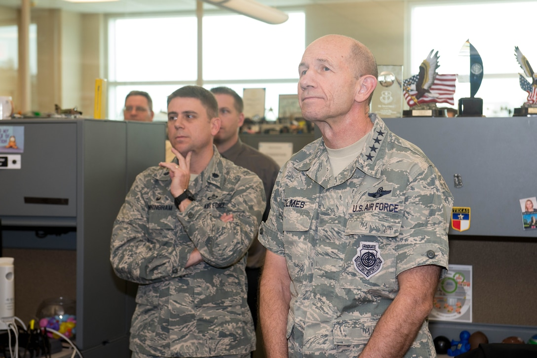 U.S. Air Force Gen. Mike Holmes, the commander of Air Combat Command, tours the 55th Weather Wing headquarters Oct. 31, 2018, at Offutt Air Force Base, Nebraska.