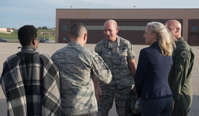 U.S. Air Force Gen. Mike Holmes, the commander of Air Combat Command, greets Chief Master Sgt. Brian Kruzelnick, 55th Wing command chief, Oct. 30, 2018, at Offutt Air Force Base, Nebraska.