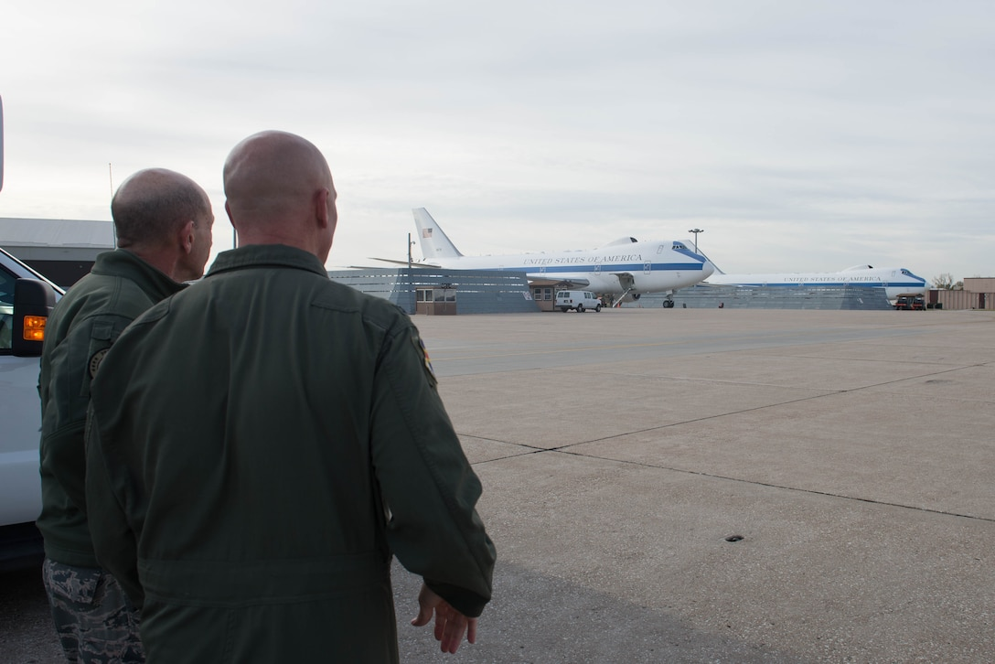 U.S. Air Force Col. Michael Manion, right, 55th Wing commander, and Gen. Mike Holmes, the commander of Air Combat Command, walk the flight line Oct. 30, 2018, at Offutt Air Force Base, Nebraska.