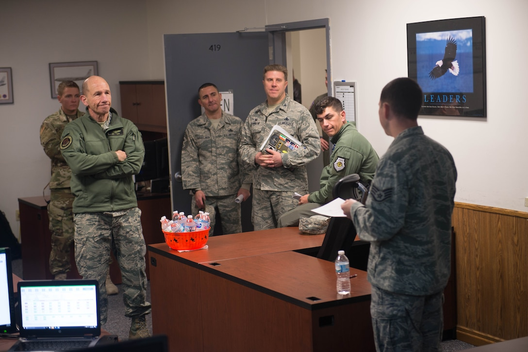 U.S. Air Force Gen. Mike Holmes, the commander of Air Combat Command, meets with the 55th Maintenance Group Emergency Management Support team in the Bennie Davis Maintenance Facility Oct. 30, 2018, at Offutt Air Force Base, Nebraska.