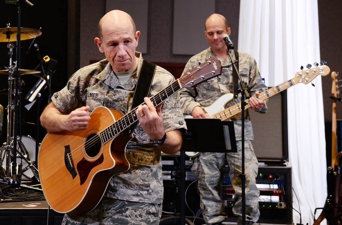 U.S. Air Force Gen. James Holmes, Air Combat Command commander, plays the guitar with the U.S. Heartland of America Band Oct. 31, 2018, inside the band's concert hall at Offutt Air Force Base, Nebraska.