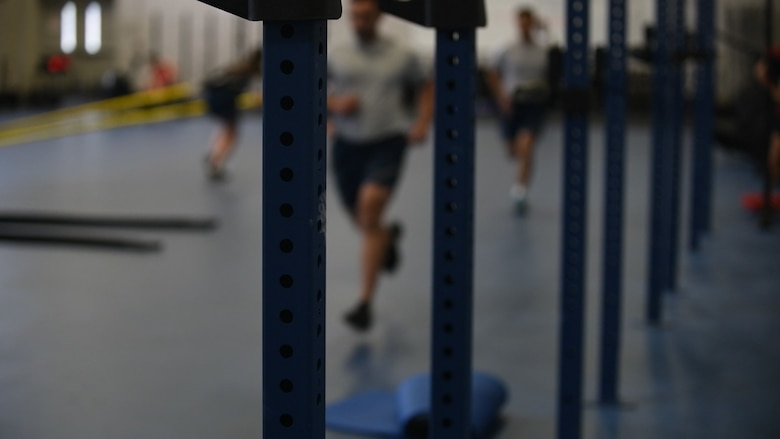 Airmen participate in a physical-training session at the 628th Force Support Squadron Fitness Center Oct. 25, 2018, at Joint Base Charleston, S.C. The PT session was part of the Centralized Fitness Improvement Program, which unifies service members with the common goal of improving their fitness. The program emphasizes the importance of exercise and nutrition and how the two complement each other to create a healthy lifestyle. Although the program is focused on the readiness of Airmen, at this time, anyone within the JB Charleston community can elect to participate in the 12-week class.