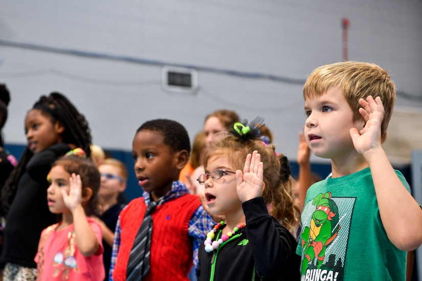 Kids from Joint Base Charleston give a drug-free pledge Oct. 23, 2018 at the youth center at Joint Base Charleston, S.C. October 23rd kicked off Red Ribbon Week, which is a week-long drug prevention and awareness program. As a part of the base's efforts to take care of service members and their families, drug demand reduction program held several events to educate military youth.