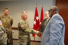 Lt. Gen. Todd Semonite, the 54th Chief of Engineers and Commanding General of the U.S. Army Corps of Engineers greeted Arthur Saulsberry, Small Business Deputy for the Kansas City District, as Northwestern Division Commander Brig. Gen. Pete Helmlinger, looks on after a Town Hall Meeting in Kansas City October 24, 2018. To the center and to the right of Lt. Gen. Semonite is Chief of the Kansas City District Construction Division, Bob Kreienheder.