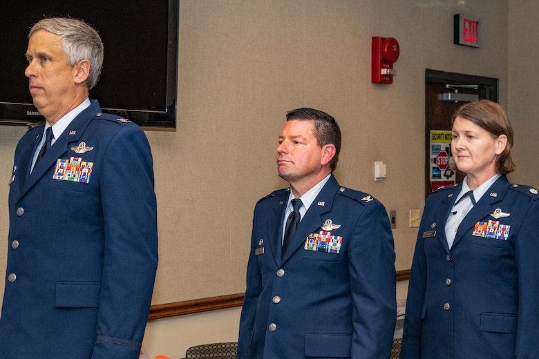 U.S. Air Force Col. Robert Burgess, Col. Shawn Werchan and Lt. Col. Joanna Mitchell stand at attention during a change of command ceremony for the 307th Operations Support Squadron at Barksdale Air Force Base, Louisiana, November 5, 2018.  Mitchell, who has more than 20 years of service in the Air Force, took command of the 307th OSS during the ceremony. (U.S. Air Force photo by Tech. Sgt. Cody Burt)