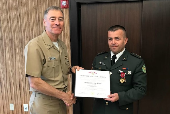 Col Chalabashvili receiving the US Legion of Merit award from NDU President Vice Admiral F.J. Roegge