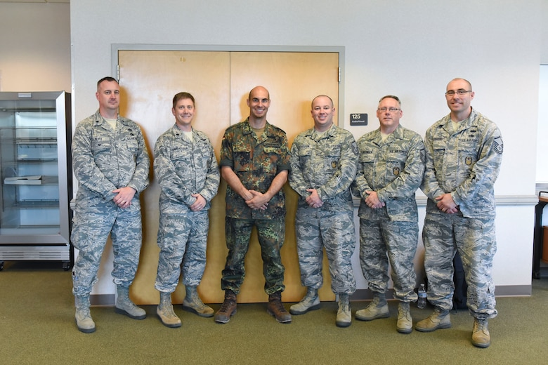 Lt. Col. Teddy Wundenber, third from left, a maintenance officer for Helicopter Wing 64 of the German Air Force, poses for a photo with the 167th Airlift Wing's inspector general staff during the 167th Airlift Wing's deployment training exercise in Alpena, Mich., June 2018. Lt. Col. James Freid-Studlo, the 167th AW inspector general, second from left, hosted Wundenberg at the 167th Airlift Wing for about two weeks as part of the Military Reserve Exchange Program.