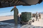 A C-17 Globemaster III operated by the 167th Airlift Wing is loaded with six generators and a Large Area Maintenance Shelter (LAMS) from the 635th Materiel Maintenance Squadron based at Holloman Air Force Base N.M., Oct. 17, 2018. The C-17 deliever the equipment to Tyndall AFB the following day with the assistance of a contingency response team from the 821st Contingency Response Group, Travis AFB, Calif. Tyndall AFB took a direct hit from Hurricane Michael, which made landfall as a category 4 storm on Oct. 10. The 635th Materiel Maintenance Group is the Air Force's only organic Basic Expeditionary Airfield Resources (BEAR) unit. The Group is responsible for the storage, inspection, repair, deployment, and accountability of BEAR assets belonging to Air Force Materiel Command and Air Combat Command. (U.S. Air National Guard photo by Senior Master Sgt. Emily Beightol-Deyerle)