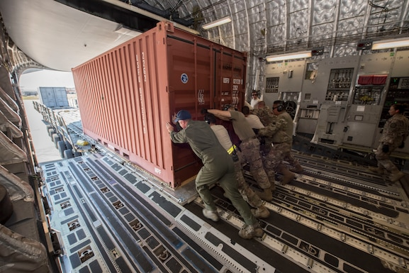 A C-17 Globemaster III operated by the 167th Airlift Wing transported six generators and a Large Area Maintenance Shelter (LAMS) from the 635th Materiel Maintenance Squadron based at Holloman Air Force Base N.M., to Tyndall Air Force Base, Fla., Oct. 18, 2018. The C-17 air crew, with assistance from the 635th MMS, loaded the cargo Oct. 17. The following day the cargo was unloaded at Tyndall AFB with the assistance of a contingency response team from the 821st Contingency Response Group, Travis AFB, Calif. Tyndall AFB took a direct hit from Hurricane Michael, which made landfall as a category 4 storm on Oct. 10. The 635th Materiel Maintenance Group is the Air Force's only organic Basic Expeditionary Airfield Resources (BEAR) unit. The Group is responsible for the storage, inspection, repair, deployment, and accountability of BEAR assets belonging to Air Force Materiel Command and Air Combat Command. (U.S. Air National Guard photo by Senior Master Sgt. Emily Beightol-Deyerle)