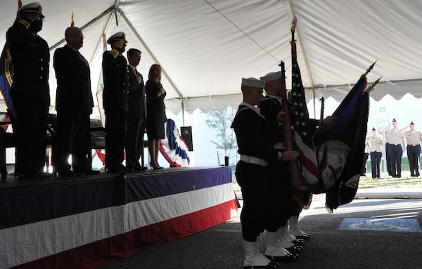 IMAGE: DAHLGREN, Va. (Nov. 1, 2018) – The Aegis Training and Readiness Center Ceremonial Color Guard presents colors during the national anthem at the ribbon-cutting ceremony for the Navy's Missile Support Facility. In the background are King George High School Junior Reserve Officer Training Corps cadets while on stage stand the event's guest speakers and the chaplain who gave the invocation. The facility features state-of-the-art labs, offices, and equipment for more than 300 NSWCDD Strategic and Computing Systems Department scientists, engineers, and technical experts who develop, test, and maintain the Submarine Launched Ballistic Missile fire control and mission planning software.