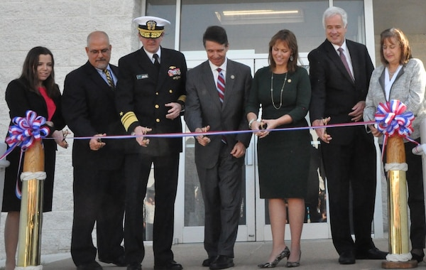IMAGE: DAHLGREN, Va. (Nov. 1, 2018) - Navy leaders and scientists are joined by local officials at the ribbon cutting ceremony for the new Naval Surface Warfare Center Dahlgren Division (NSWCDD) Missile Support Facility. The facility features state-of-the-art labs, offices, and equipment for more than 300 NSWCDD Strategic and Computing Systems Department scientists, engineers, and technical experts who develop, test, and maintain the Submarine Launched Ballistic Missile fire control and mission planning software. From left to right: Lauren Falkenstein, a scientist representing the NSWCDD Strategic and Computing Systems Department's newly-hired junior workers; John Fiore, NSWCDD technical director; Vice Adm. Johnny Wolfe, director of Navy Strategic Systems Programs; U.S. Rep. Rob Wittman; Margaret Ransone, Virginia delegate; Kyle Jones, head of the NSWCDD Strategic and Computing Systems Department; Lisa Weisbeck, a scientist representing the NSWCDD Strategic and Computing Systems Department's senior level workers.