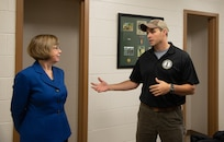 Bluefield State College President Marsha Krotseng speaks with Sgt. 1st Class Teddy Scouras, a recruiter for the West Virginia Army National Guard, inside the new recruiting office in the W. Paul Cole, Jr. School of Business/Mahood Hall Nov. 2, 2018 in Bluefield, West Virginia. The recruiting office at Bluefield State marks the newest location for the WVARNG in the southernmost part of the state, the only one of which is at a higher education institution. (U.S. Air National Guard photo by Capt. Holli Nelson)