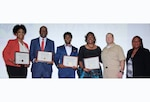 Group of men and women holding certificates