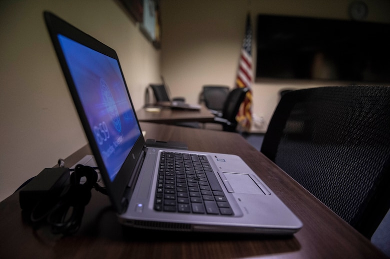 A laptop is ready for use for the Defense Travel System Help Desk program