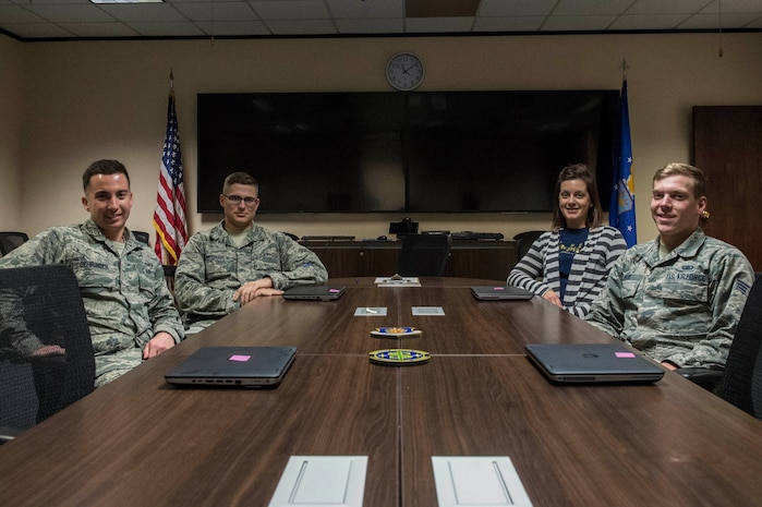 Members of the 97th Comptroller Squadron who help with the Defense Travel System Help Desk program, await members of the base who need assistance with DTS