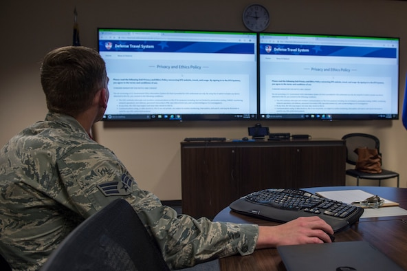 U.S. Air Force Senior Airman Brandon Bray, a financial operations technician assigned to the 97th Comptroller Squadron opens the Defense Travel System website