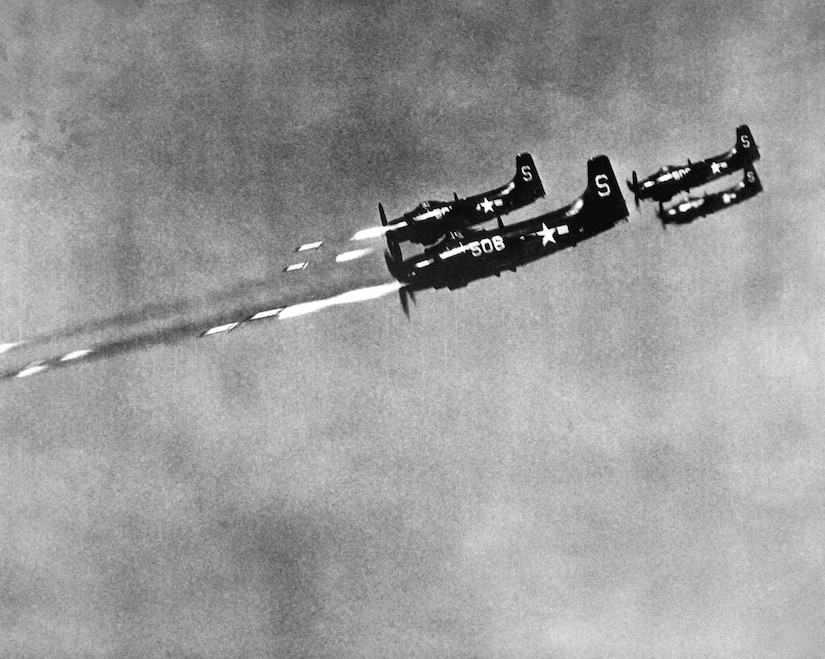 Navy Sky Raiders from USS Valley Forge fire 5-inch wing rockets at North Korean field positions, October 24, 1950 (U.S. Navy/Burke)