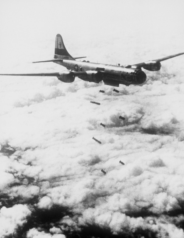 Lead bomber attacks enemy positions, as seen from B-29 Superfortress of Far East Air Forces 19th Bomber Group on its 150th combat mission since start of Korean War (Air and Space Museum)