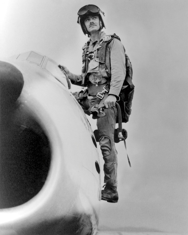 """Major John F. Bolt, USMC, with his U.S. Air Force F-86 """"Sabre"""" jet fighter, July 13, 1953, two days after he shot down his fifth and sixth MiG-15s (U.S. Marine Corps/ Tom Donaldson)"""