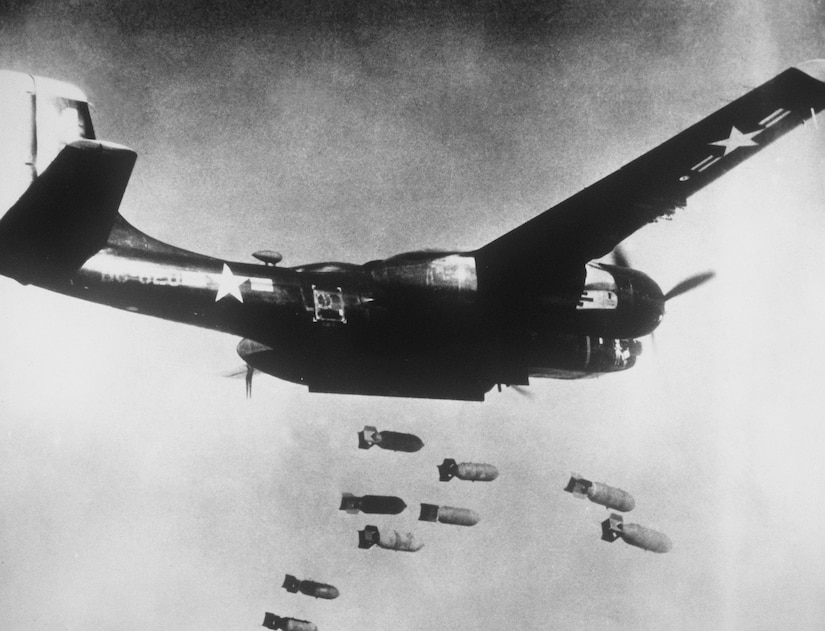 Black-painted U.S. Air Force Douglas B-26C Invader assigned to 3rd Bomb Wing, 5th Air Force, drops bombs over communist target in North Korea, ca. 1953 (Air and Space Museum)